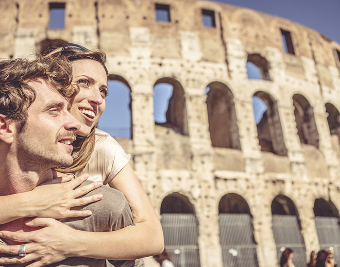 A couple in front of the Colosseum